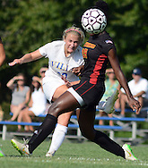 Villa Joseph Marie's Casey Kilchrist #20 shoots the ball past Gwynedd Mercy Academy's Kimberly Sanford #19 in the first half of a girls soccer game at Villa Joseph Marie Tuesday September 8, 2015 in Richboro, Pennsylvania.  (Photo by William Thomas Cain)