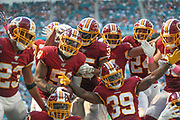 Sunday, October 13, 2019; Miami Gardens, FL USA;  Washington Redskins cornerback Quinton Dunbar (23) linebacker Shaun Dion Hamilton (51) strong safety Montae Nicholson (35) cornerback Jimmy Moreland (32) cornerback Josh Norman (24) Washington Redskins linebacker Cole Holcomb (55) and defensive back Jeremy Reaves (39) celebrate an interception during an NFL game against the Dolphins at Hard Rock Stadium. The Redskins beat the Dolphins 17-16. (Kim Hukari/Image of Sport)