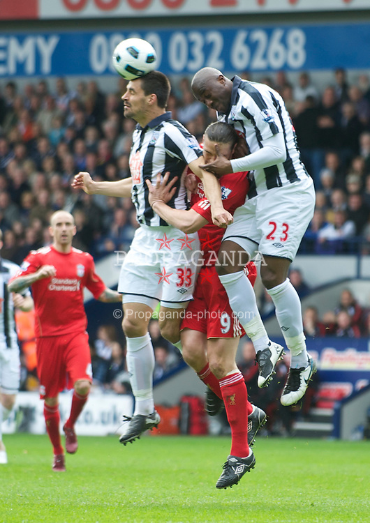 WEST BROMWICH, ENGLAND - Saturday, April 2, 2011: West Bromwich Albion's Paul Scharner and Abdoulaye Meite challenge Liverpool's Andy Carroll during the Premiership match at The Hawthorns. (Photo by Dave Kendall/Propaganda)