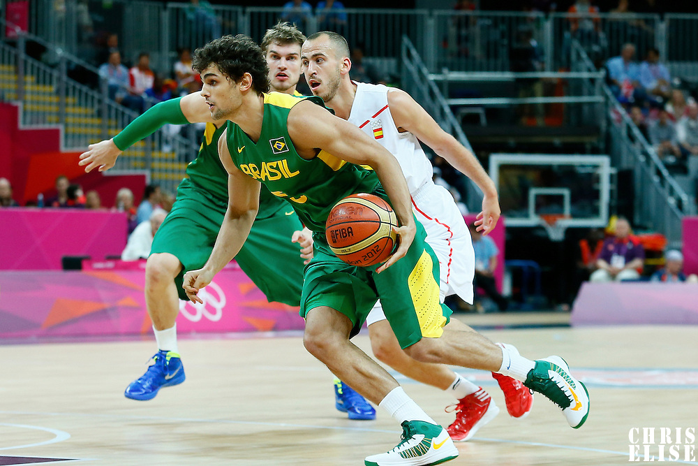 06 August 2012: Brazil Raul Neto drives past Sergio Rodriguez during 88-82 Team Brazil victory over Team Spain, during the men's basketball preliminary, at the Basketball Arena, in London, Great Britain.