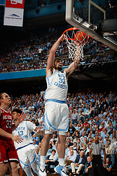 CHAPEL HILL, NC - FEBRUARY 05: Luke Maye #32 of the North Carolina Tar Heels dunks the ball during a game against the North Carolina State Wolfpack on February 05, 2019 at the Dean Smith Center in Chapel Hill, North Carolina. North Carolina won 113-96. North Carolina wore retro uniforms to honor the 50th anniversary of the 1967-69 team. (Photo by Peyton Williams/UNC/Getty Images) *** Local Caption *** Luke Maye