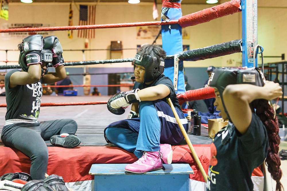 Baltimore, Maryland - January 26, 2017: Boxers Lynnera Spriggs, 15, left, Kyerianna &quot;lil mama&quot; Foro, 11, and Candice Carter, 17, hangout ringside before sparring at the Upton Boxing Club in Baltimore. <br /> <br /> CREDIT: Matt Roth for The New York Times<br /> Assignment ID: