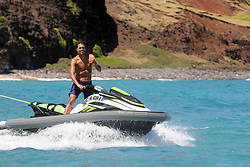 *PREMIUM EXCLUSIVE* Mark Zuckerberg takes to the high seas in Hawaii riding an eFoil.The billionaire Facebook founder and CEO looked to be in the early stages of mastering the the $12,000 electric hydrofoil, which gives the sensation of flying over water.He was closely followed by his security detail and professional surfer Kai Lenny, who appeared to be instructing him. Zuckerberg's face was thickly coated in sunscreen. Being able to surf without wind or waves, eFoiling is one of the fastest-growing trends in outdoor recreation, Zuckerberg, 36, recently became the fourth-richest person in the world as his net worth rose to a staggering $86.5billion. He is staying at his sprawling $100million estate on Kauai with wife Priscilla Chan, their toddler daughters Max and August, He began snapping up 700 acres of land on the island's north shore in 2014. The massive property is an ideal setting to ride out the coronavirus pandemic gripping the nation as it offers both seclusion and stunning views while Zuckerberg and all of his staff work from home for the foreseeable future. 18 Jul 2020 Pictured: Mark Zuckerberg. Photo credit: MEGA TheMegaAgency.com +1 888 505 6342