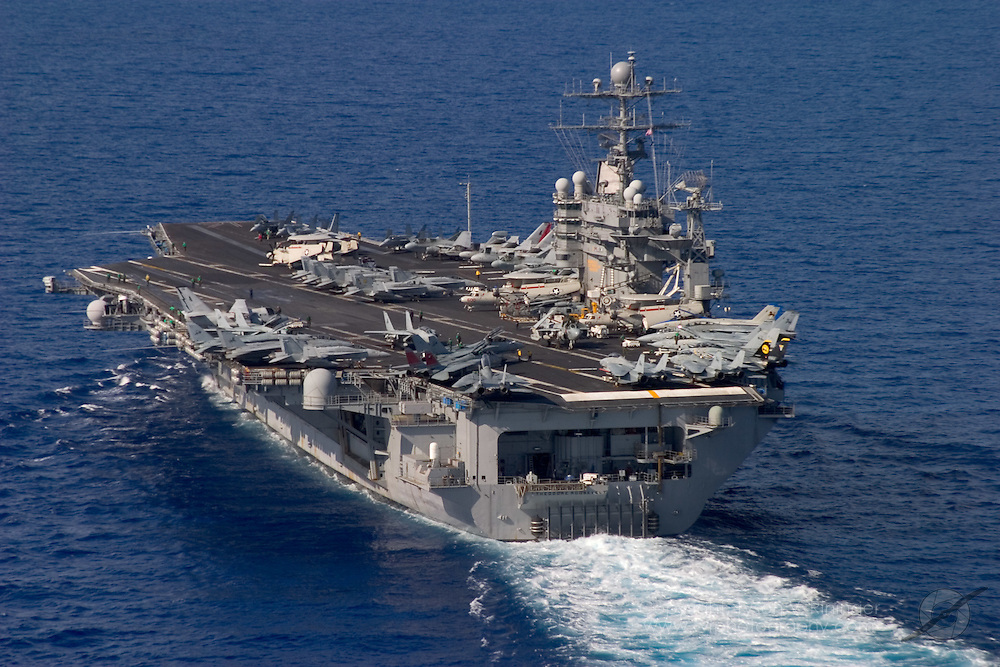 The USS Theodore Roosevelt CVN-71 prepares for deployment to the Mediterranean. This would be the last time the famed F-14 Tomcat would see operations aboard an aircraft carrier.