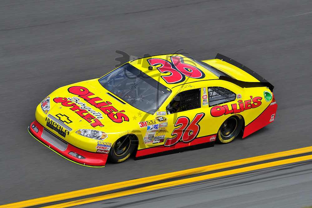 Daytona Beach, FL - FEB 18, 2012: Dave Blaney (36) on track in turn 3 during practice for the Daytona 500 race at the Daytona International Speedway in Daytona Beach, FL.