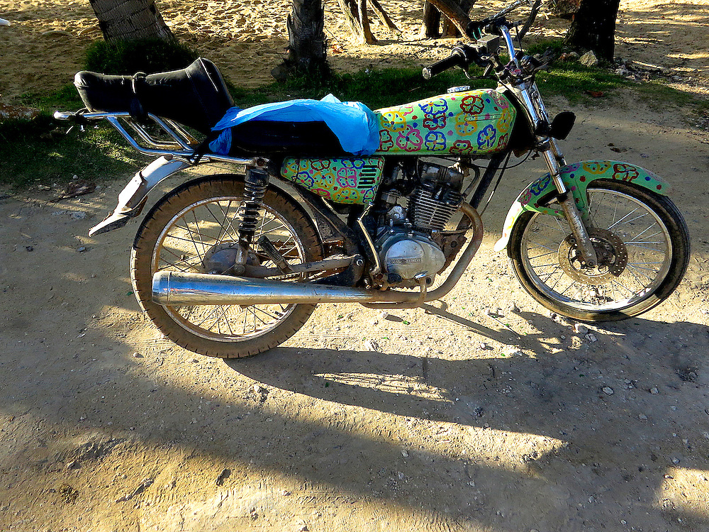 Peace logos on motorcycle for hire, Dominican Republic