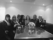 Ronnie Wood, Jo Wood, Kate Moss, Saffron Burrows, Lucy Yeomans, David Bailey and Manolo Blahnik in the kitchen.<br />David Bailey dinner hosted by Lucy Yeomans at Gordon Ramsay at Claridge's. 12 November 2001. © Copyright Photograph by Dafydd Jones 66 Stockwell Park Rd. London SW9 0DA Tel 020 7733 0108 www.dafjones.com