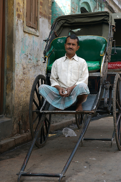 "Mohammad Asgar does not know his exact age but he knows that for the last twenty six years he has been pulling a rickshaw on the streets of Calcutta..He earns an average of about Rs100 a day (2-3 US$) out of which he pays 20 rupees as rent for his vehicle, 30 rupees for food and the rest goes to his wife and three children in Muzaffarpur, Bihar. .The hand-pulled rickshaw of Calcutta, immortalised by Dominic Lapierre's famous novel, City of Joy, will soon be a part of the history books as a bill passed by the West Bengal state assembly described the centuries-old mode of transport as ""inhumane."".The future of about 18,000 rickshaw pullers in the city, earning an avarage daily wages of about 100 rupees ($2.5).is unclear as they call for a compensation package to help them rehabilitate into alternative jobs."