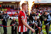 John Lundstram of Sheffield United walks out for the Premier League match between Sheffield United and Crystal Palace at Bramall Lane, Sheffield, England on 18 August 2019.
