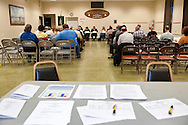 After Nassau County Coalition of Civic Associations installs Board Directors, on Tuesday, April 17, 2012, at Lido Beach, New York, USA, concerns such as the County's proposal to lease sewage treatment plants, and legislature redistricting, are discussed. In foreground are sign in sheets. The non-partisan group believes transparency and public oversight are necessary to protect residents. Executive Directors to the Board present were these civic leaders: George Pombar of Glen Head, Phil Healey; Patrice Benneward of Glenwood Landing, Raymond Pagano of Oceanside, Claudia Borecky of North Merrick, Phil Franco of Seaford, and Greg Naham of Lido Beach.