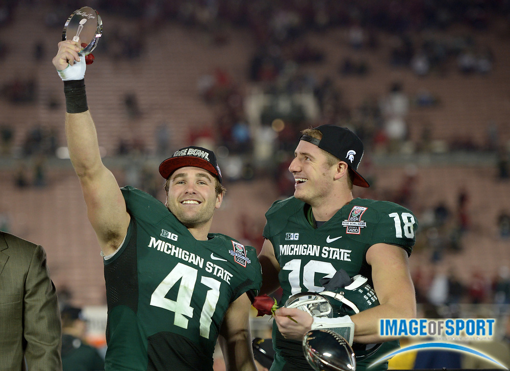 Jan 1, 2014; Pasadena, CA, USA; Michigan State Spartans linebacker Kyler Elsworth (41) and quarterback Connor Cook (18) celebrate after the 100th Rose Bowl against the Stanford Cardinal. Michigan State defeated Stanford 24-20.