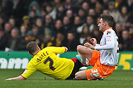 Picture by David Horn/Focus Images Ltd +44 7545 970036.09/03/2013.Mark Yeates of Watford and Matt Derbyshire of Blackpool challenge for the ball during the npower Championship match at Vicarage Road, Watford.