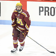 Brady Skjei #2 of the Minnesota Gophers warms up on the ice prior to the game against the Northeastern Huskies at Matthews Arena on November 29, 2014 in Boston, Massachusetts. (Photo by Elan Kawesch)