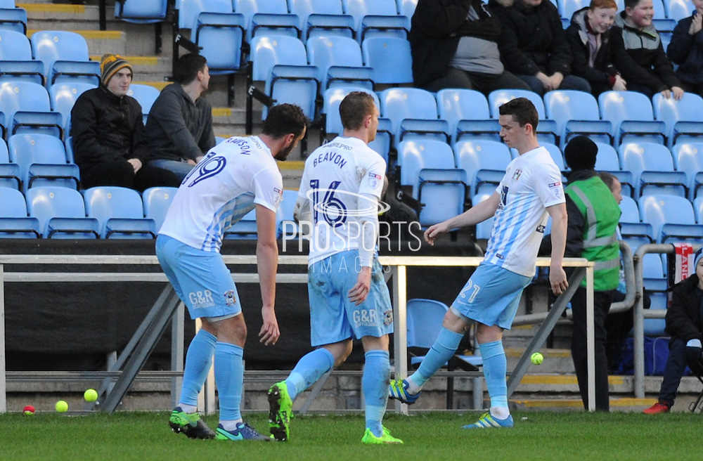 Coventry City players pick up tennis balls thrown on the pitch in protest over owners during the EFL Sky Bet League 1 match between Coventry City and Millwall at the Ricoh Arena, Coventry, England on 4 February 2017. Photo by Andy Handley.