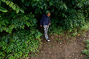 Tommy Yarberry walks out of the woods where he has been camping for around 4 months on Tuesday, Aug. 14, 2018. Yarberry, who has been homeless for three years, will be the first resident to move into Eden Village.