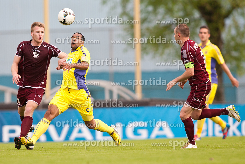 Anze Jelar & Jalen Pokorn of NK Triglav and Marcos Tavares of NK Maribor during football match between NK Triglav and NK Maribor in 1st leg of semifinal of Slovenian Cup 2012/2013, on May 1, 2013, in Sports park, Kranj, Slovenia. (Photo By Grega Valancic / Sportida.com)