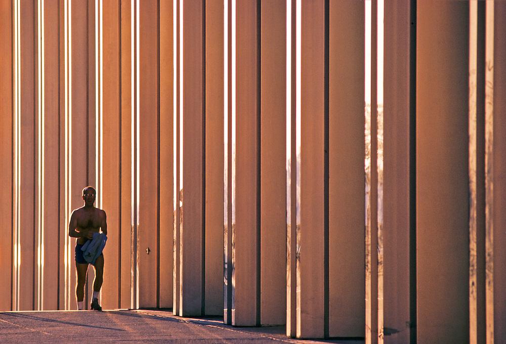 Man  NYC, NY, Golden Twin Towers, World Trade Center, designed by Minoru Yamasaki, International Style II, sunset