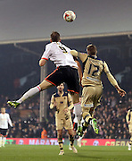 Matt Smith header beating Gaetano Beradi during the Sky Bet Championship match between Fulham and Leeds United at Craven Cottage, London, England on 18 March 2015. Photo by Matthew Redman.