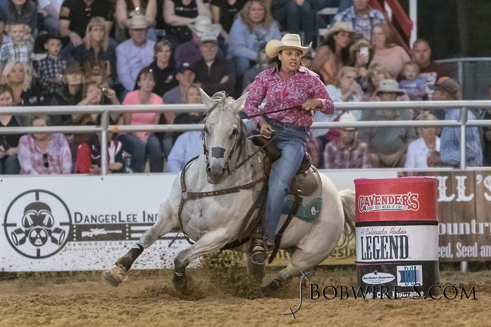 Melanie Luark makes her run in the barrel racing during the second performance of the Elizabeth Stampede on Saturday, June 2, 2018.