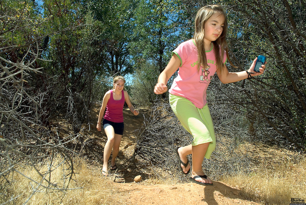Geocaching has become a popular family activity for residents of the north state.  Local Dentist Mike Nelson, 50, of Redding has placed over 60 caches throughout the north state.  He makes it a family affair taking his daughter Kendra Nelson, 20, in the pink and black shorts, his nephew, Cory Short, 14 and nieces, Lydia Short, 10 in the Pink Monkey shirt and Elaina Short, 8 in the blue shirt.  The team is placing a cache at Mary Lake. The cache is marked as Falks Lake because that is the former name of the lake.