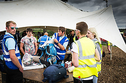 Security checking bags at the Brownstock festival.