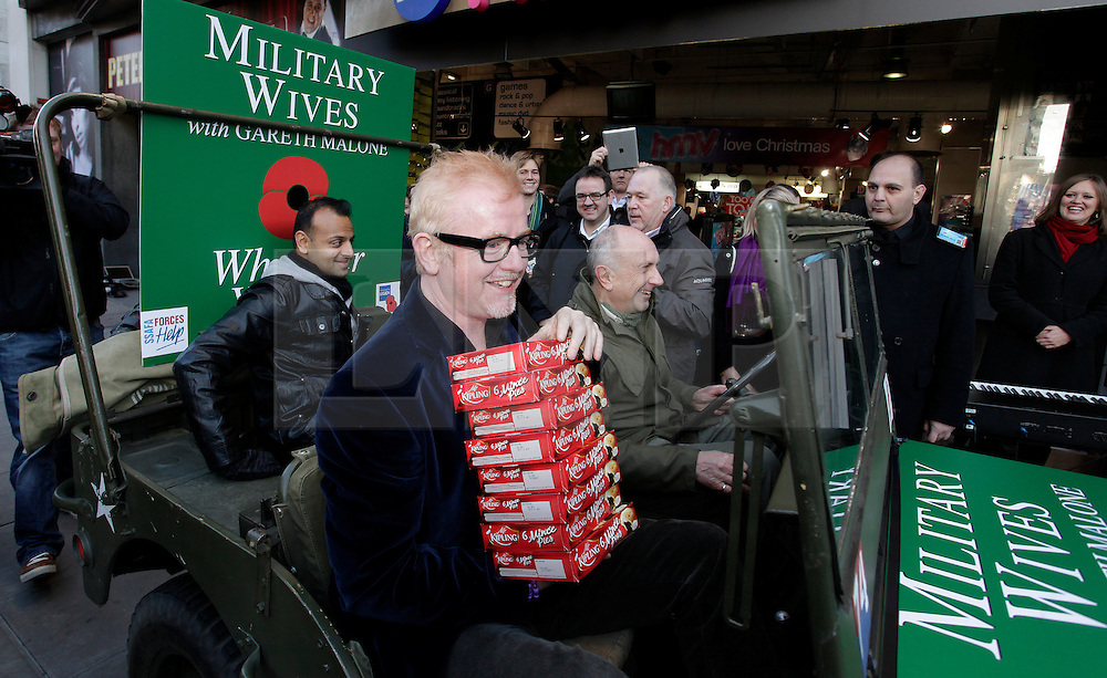 © Licensed to London News Pictures. 20/12/2011. London, United Kingdom .Chris Evans delivers mince pies to the Military Wives Choir outside of HMV on Oxford Street to celebrate the success of the Military Wives single..Photo credit : Chris Winter/LNP