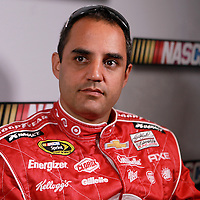 Driver Juan Pablo Montoya speaks with the media during the NASCAR Media Day event at Daytona International Speedway on Thursday, February 14, 2013 in Daytona Beach, Florida.  (AP Photo/Alex Menendez)