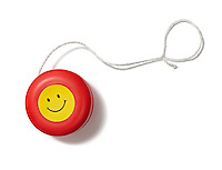 Red smiley face yoyo on white background