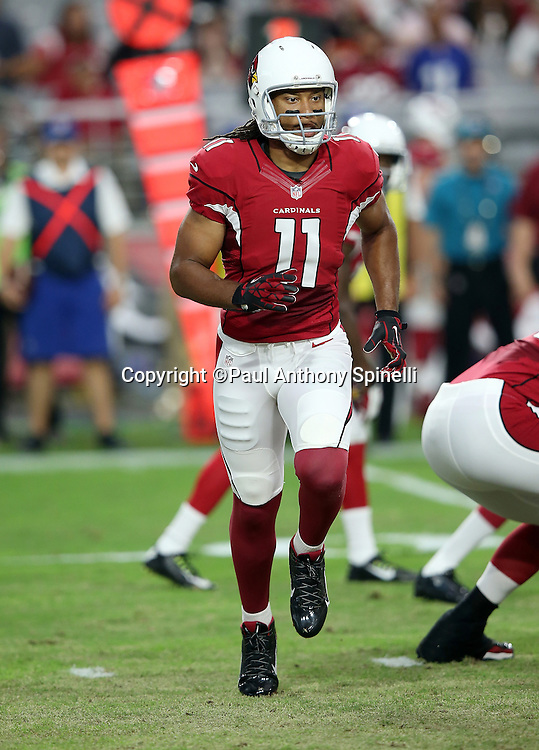 Arizona Cardinals wide receiver Larry Fitzgerald (11) goes in motion during the 2015 NFL preseason football game against the Kansas City Chiefs on Saturday, Aug. 15, 2015 in Glendale, Ariz. The Chiefs won the game 34-19. (©Paul Anthony Spinelli)