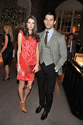 DAVID GANDY and SARAH ANN MACKLIN at a dinner hosted by Asprey for The Woodland Trust in support of the Jubilee Woods Project, held at Asprey, 167 New Bond Street, London on 22nd November 2012.