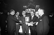 05/04/1966<br /> 04/05/1966<br /> 05 April 1966<br /> Presentation Awards for entries in the N.A.I.D.A. Parade at the Shelbourne Hotel, Dublin. Photo shows Mr. L.V. Nolan, (left) President of the N.A.I.D.A., presenting a special prize for the best voluntary exhibit to Mr. Christopher Carroll, (Catholic Housing Aid Society). Also in the picture are Mr. C.J. Thompson, (Thompson Barnett and Co.); Mr. T.F. Geoghegan (Bord Iascaigh Mhara); Mr. James Skelly, (Skelly's Tube Loom) and Mr. T.A. Lynch, Chairman, St. Patrick's Day Committee.