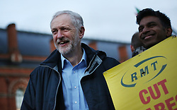 © Licensed to London News Pictures. 04/01/2016. London, UK. Labour leader Jeremy Corbyn joins a demonstrator at King's Cross station calling for lower rail fares. Photo credit: Peter Macdiarmid/LNP