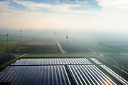 Nederland, Groningen, Delfzijl, 04-11-2018; Sunport Delfzijl, het grootste zonne-energiepark van Nederland. Het park levert onder andere stroom aan het Google datacentre in de nabij gelegen Eemshaven. In de achtegrond windmolens.<br /> Sunport Delfzijl, the largest solar energy park in the Netherlands. The park supplies power to the Google data center in the nearby Eemshaven.<br /> <br /> luchtfoto (toeslag op standaard tarieven);<br /> aerial photo (additional fee required);<br /> copyright&copy; foto/photo Siebe Swart
