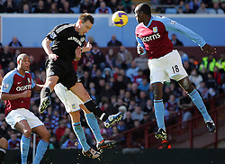 Chelsea captain John Terry gets in a header which hits the bar during the Barclays Premier League match between Aston Villa and Chelsea at Villa Park on February 21, 2009 in Birmingham, England.