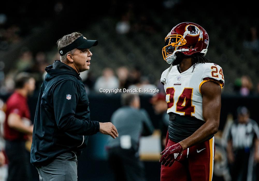 Nov 19, 2017; New Orleans, LA, USA; New Orleans Saints head coach Sean Payton talks with Washington Redskins cornerback Josh Norman (24) before a game at the Mercedes-Benz Superdome. Mandatory Credit: Derick E. Hingle-USA TODAY Sports