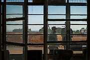 A security guard watches the passenger waiting area of the Arua airfield.