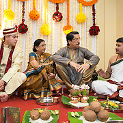 Groom with his parents at the starting of the wedding ceremony