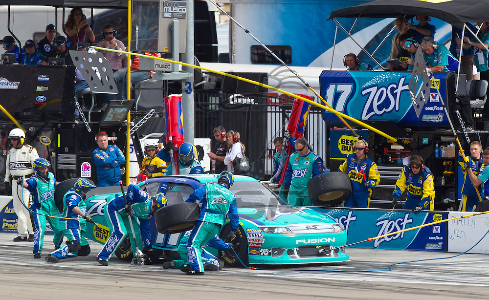LAS VEGAS, NV - MAR 11, 2012:  Matt Kenseth (17) brings his car in for service during the Kobalt Tools 400 race at the Las Vegas Motor Speedway in Las Vegas, NV.