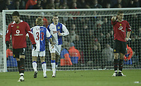 Photo: Aidan Ellis.<br /> Blackburn v Manchester United. Barclays Premiership. 01/02/2006.<br /> Blackburn's David Bentley celebrates his second goal with Michael Gray as United's Nemanja Vidic holds his head