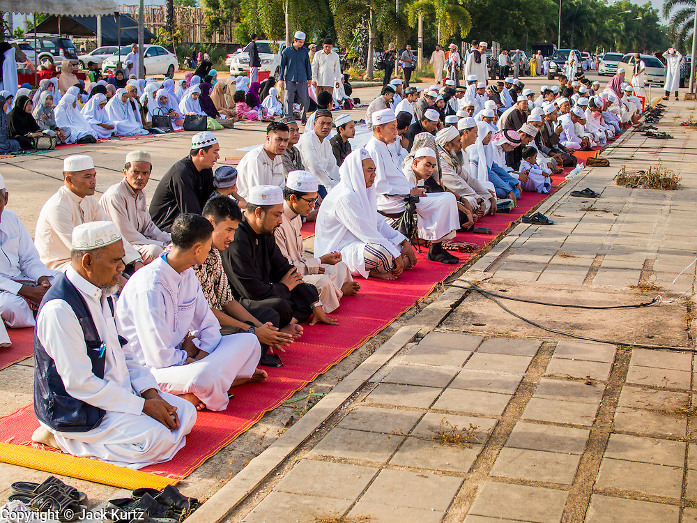 Men pray before Eid services at Songkhla Central Mosque in Songkhla province of Thailand. Eid al-Fitr is also called Feast of Breaking the Fast, the Sugar Feast, Bayram (Bajram), the Sweet Festival and the Lesser Eid, is an important Muslim holiday that marks the end of Ramadan, the Islamic holy month of fasting.