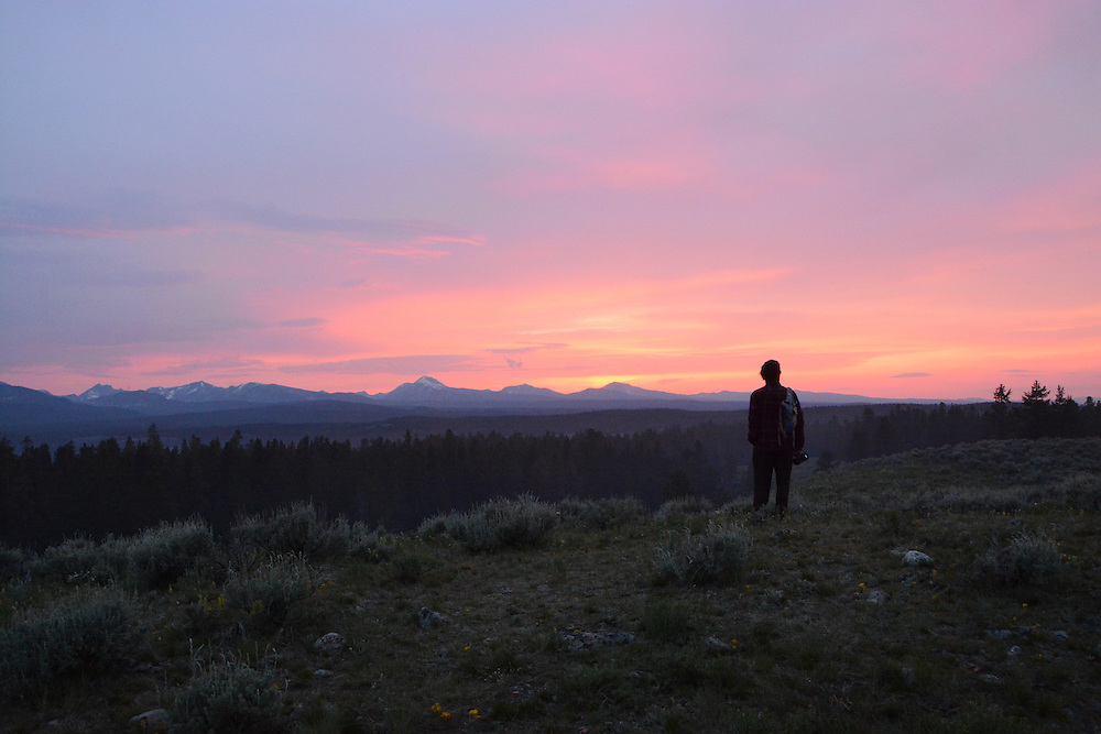 Sunset over the mountains at the gathering.  Rainbow Gatherings started back in 1972, acts of self-expression, inclusiveness, and the right to peacefully assemble. Rainbow Gathering 2013 was held in Montana, outside of Jackson.
