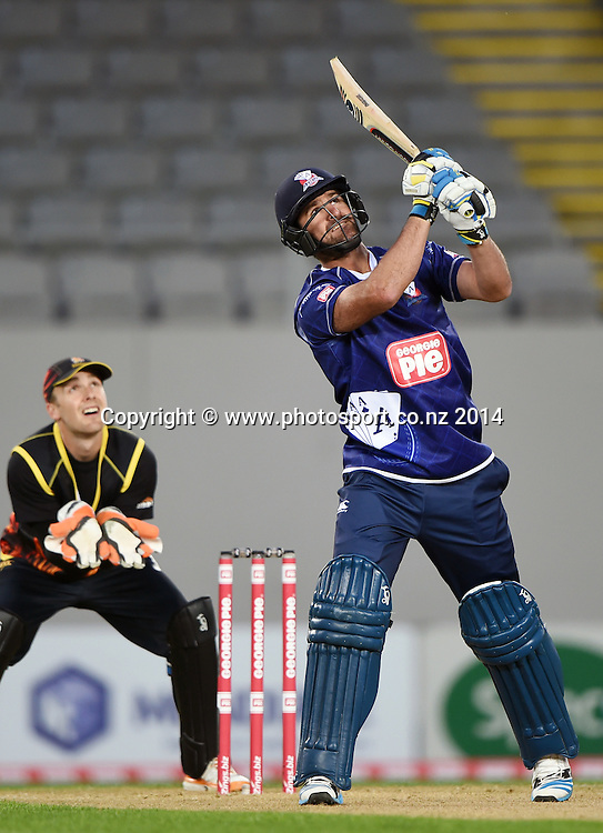 Colin de Grandhomme in action for Auckland during the Georgie Pie Super Smash Twenty20 cricket match between the Auckland Aces and Wellington Firebirds at Eden Park, Auckland on Friday 14 November 2014. Photo: Andrew Cornaga / www.Photosport.co.nz