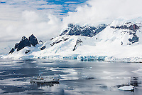 Akademic Sergey Vavilov anchors along the Danco Coast while exploring the antarctic Peninsula.  Danco, Antarctic Peninsula, Antarctica