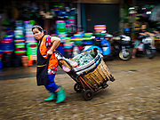08 JUNE 2017 - BANGKOK, THAILAND:  A porter makes a delivery in Khlong Toey Market, Bangkok's main fresh market. Thai consumer confidence dropped for the first time in six months in May following a pair of bombings in Bangkok, low commodity prices paid to farmers and a sharp rise in the value of the Thai Baht versus the US Dollar and the EU Euro. The Baht is surging because of political uncertainty, related to Donald Trump, in the US and Europe. The Baht's rise is being blamed for a drop in Thai exports. This week the Baht has been trading at around 33.90 Baht to $1US, it's highest point in two years.     PHOTO BY JACK KURTZ