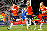 Andre Gray of Luton Town (left) celebrates scoring his team's first goal to make it 1-1 during the Skrill Conference Premier match at Kenilworth Road, Luton<br /> Picture by David Horn/Focus Images Ltd +44 7545 970036<br /> 21/04/2014