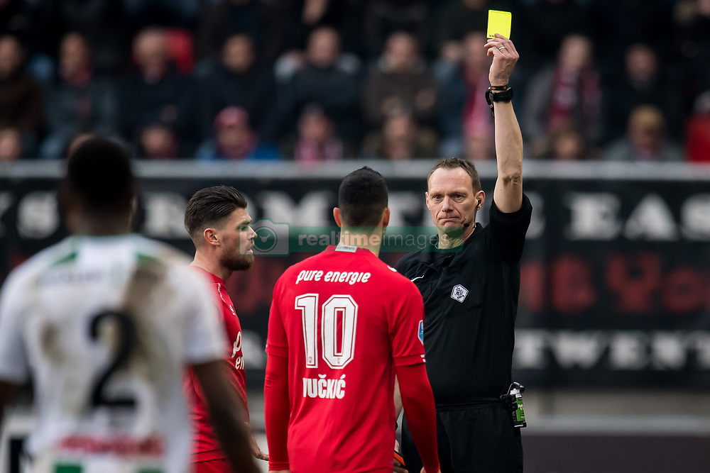 (L-R) Haris Vuckic of FC Twente, referee Ed Janssen during the Dutch Eredivisie match between FC Twente Enschede and FC Groningen at the Grolsch Veste on March 04, 2018 in Enschede, The Netherlands