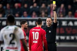 (L-R) Haris Vuckic of FC Twente, referee Ed Janssen during the Dutch Eredivisie match between FC Twente Enschede and FC Groningen at the Grolsch Veste on March 04, 2018 in Enschede, The Netherlands