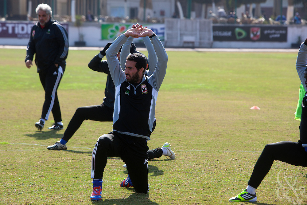 Egyptian footballer Mohamed Aboutrika (c), stretches with teamates at the Al-Ahly club in Zamalek, Cairo Feb 20, 2012 during their first practice back since the Port Said violence that claimed the lives of at least 74 Egyptian soccer fans Feb 01, 2012.