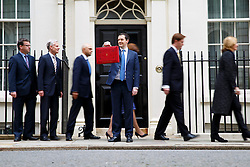 LNP Weekly Highlights 21/03/14 © licensed to London News Pictures. London, UK 19/03/2014. Chancellor of the Exchequer George Osborne posing for photographers outside 11 Downing Street before presenting his annual budget to Parliament on Wednesday, 19 March 2014. Photo credit: Tolga Akmen/LNP