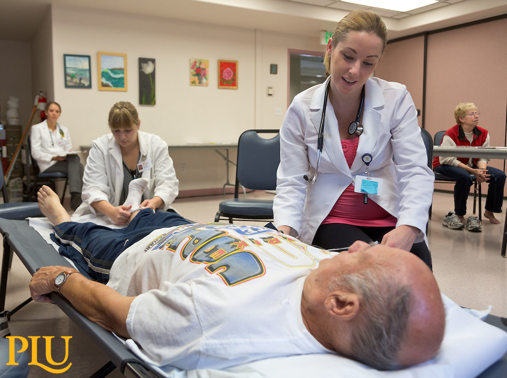 PLU Nurse Practitioner students working in a clinic at the Sumner Senior Center on Thursday, Sept. 25, 2014. (Photo/John Froschauer)
